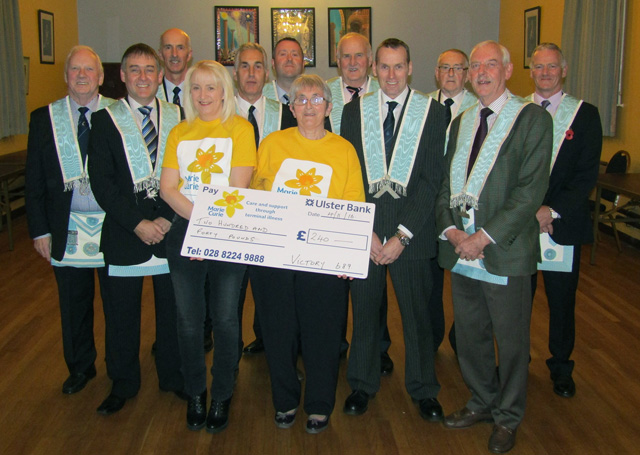 Representatives from Marie Curie pictured receiving a cheque for £240 from brethren of Victory Masonic Lodge 689, Omagh
