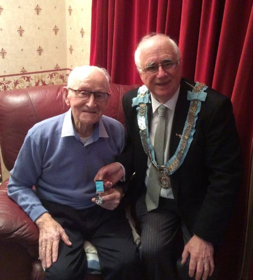 Bro James Warnock receiving a Tyrone and Fermanagh 150 year jewel from PGM RWBro Maurice Lee